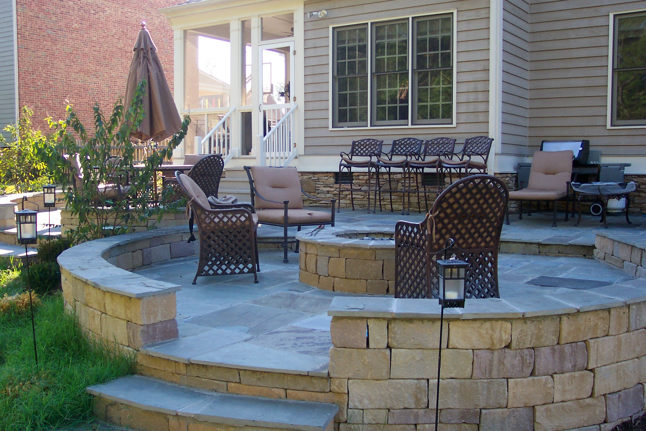 The age old debate paver patio vs wood deck ask the for Fireplace on raised deck