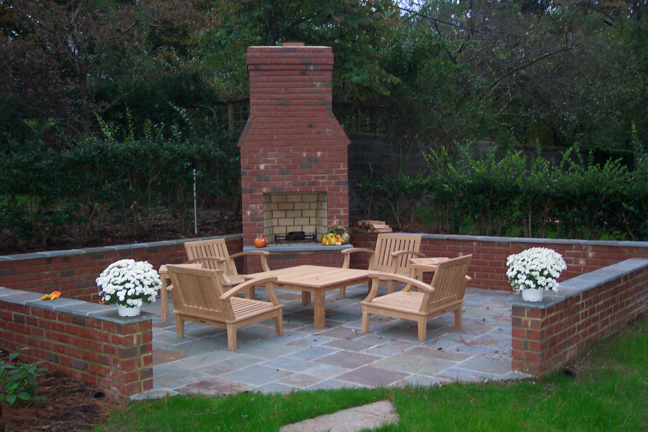 outdoor brick fireplace | Ask the Landscape Guy