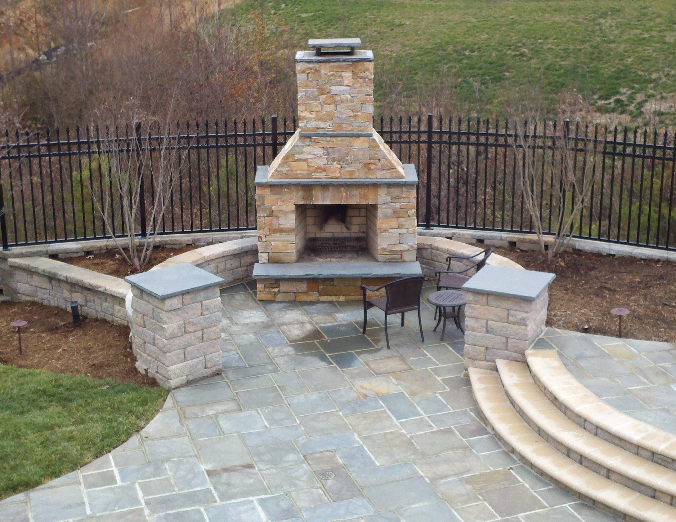 Beautiful pool with bluestone patios and stone fireplace for Pictures of stone patios